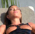 VIDEO: Sunbathing in Black Latex